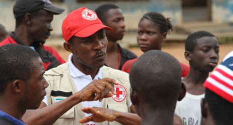 Sierra Leone Red Cross teams visit communities in the eastern district of Kailahun, to try and teach people how to protect themselves. Many communities remain in denial about the existence of the deadly virus. Photo: Katherine Mueller, IFRC